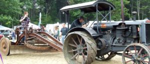 Antique tractor with grader